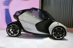 The electric i-Tril's range is given as over 200 km (124 mi) per charge