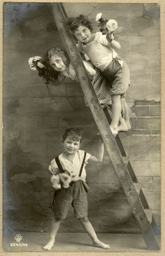 Kids on a ladder picture postcard