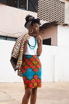 Yevu Ghana. I'm starting to realize how good plan white shirts look with African inspired jewelry.