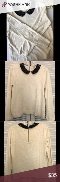 J.CREW FACTORY PETER PAN LACE COLLAR TOP Beautiful textured long sleeve top with dainty lace/silk Peter Pan collar.  Zipper at back neck.  100% slub cotton.  Small snag on left sleeve (see photo). Tiny blemish on front left side of top (see photo).  Faint hidden stain hidden at interior neck  (see photo).  Size Medium. Worn with love! J.Crew Factory Tops Blouses