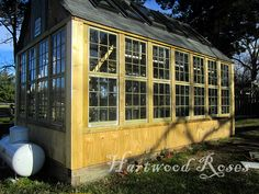 This greenhouse began as an idea and a pile of wood framed windows salvaged from 1960s and 70s houses in 2008. It's framed like a large garden shed, with a foundation made from salvaged 6x6 timbers, 4x4 studs, 2x6 rafters.