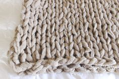 How to Arm Knit a Blanket in 45 Minutes! | interesting use of those cheesy ruffle yarns