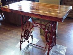 On a trip to find something to recreate - we happened upon some deals - A Vintage Singer Sewing Machine Base (No Sewing Machine- pedal missing) and some Reclaimed Red Cedar. We took the advice of a local store owner who specializes in Vintage and Antique sales and decided to create a new piece. Some term it Steampunk, Some term it Unique, We term it Beautiful! Measurements are (21 1/2in. Wide/Deep x 35in. Length x 29 1/2in. Tall/Height) The Base is cast iron base from a Singer Sewing…