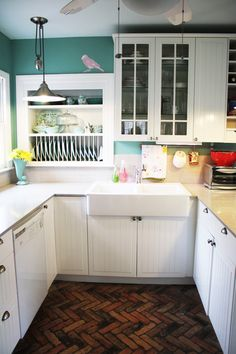 We used these IKEA STAT cabs in our last kitchen remodel (only with red walls and butcher block countertops) and I miss my old kitchen! I like the blue-green on the walls here, and the herringbone-style floor.