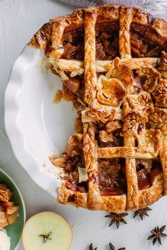 Put a delicious twist on a traditional apple pie recipe by baking this chai apple pie! Combine apple juice, chai tea, honey crisp apples, cinnamon, ginger, cardamom, brown sugar, maple syrup, and vanilla to create this easy fall dessert recipe. Your friends and family will love eating this pie for Christmas or Thanksgiving dessert!