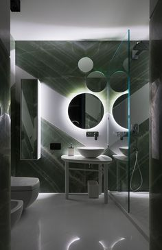 In the childrens' bathroom, white Thassos marble walls and floors frame expanses of onyx marble; the sink is by Simas.
