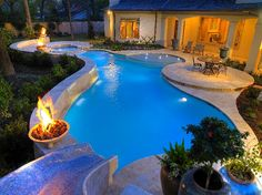Pool with mosaic slide,hot tubs and fire pit