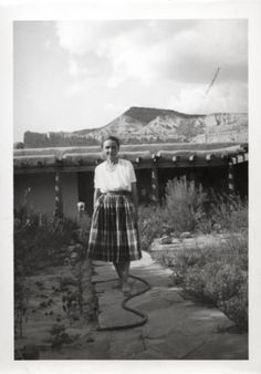 """Maria Chabot, """"Georgia O'Keeffe, Ghost Ranch House Patio,"""" 1944. Photographic print,  5 x 3 1/2 in. Georgia O'Keeffe Museum. Gift of Maria Chabot. RC-2001-002-123a. Copyright Georgia O'Keeffe Museum."""