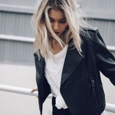 White romantic and girly top combined with the tough masculine look of a leather jacket ❤️