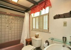 Bathroom, love the tiles, needs new to me footed soaking tub in there!