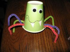 spider craft with paper cup, marker, google eyes and pipe cleaners