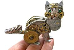Intricate steampunk sculptures lovingly constructed with antique watch parts