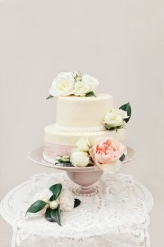 Two tier wedding cake, simple but very pretty, like the ribbon round the bottom of the tiers being different widths and colours