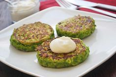 Pea Fritters -- Ingredients :   1 pound frozen peas ;  1/2 cup low fat Greek yogurt ;  2 large eggs ;  1/4 cup chopped Italian parsley ;  1 tablespoon minced garlic ;  1 small onion, finely diced ;  1/2 cup whole-wheat flour ;  1 teaspoon kosher salt ;  1/2 teaspoon ground cumin ;  1/4 teaspoon black pepper ;  Olive oil cooking spray