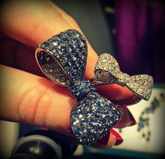 Bow rings by Mimi So: one with blue sapphires and diamonds in white gold and one with diamonds in white gold. Via Diamonds in the Library.