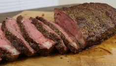 Smoked New York Strip Loin recipe for a NY Strip Loin Roast smoked whole to a perfect medium rare and then sliced and served.