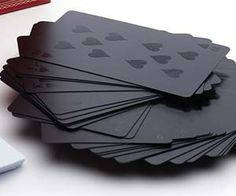 the black on black playing cards. These monochromatic cards offer an eye catching all black facade so alluring it may distract your opponents from the actual game and improve your odds. Buy It $14.85 via GentSupplyCo.com