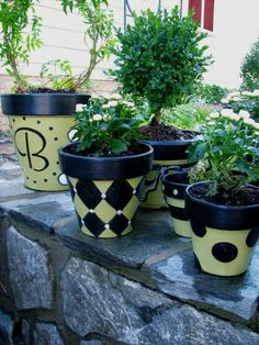 Painted Pots , I wanted some planters and   pots to coordinate with a table I painted and some new outdoor cushions, but   could not find anything I liked, so... DIY!  , I like the whimsical feel of   polka dots and harlequin prints and it was fun to be able to use them on my   patio.  , Other Spaces Design