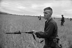 Photos: Haunting, Rarely Seen Images from the Battle Lines of the Vietnam War | Vanity Fair A young marine goes into battle. 1965