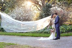 Bride and Groom with Veil in Wind
