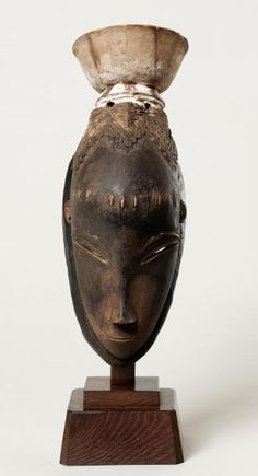 Mask (Gu)  late 19th–early 20th century Guro peoples Côte d'Ivoire Wood, pigment 12 3/4 x 5 x 5 1/2 in. (32.4 x 12.7 x 14 cm) (with mount): 16 3/4 x 5 1/8 x 7 in. (42.5 x 13 x 17.8 cm)