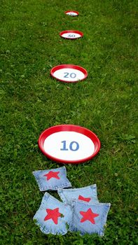 Strike up a game of Bean Bag Toss. With a little bit of stitch'n or maybe some stitch whitchery for those of you who don't sew, you can whip up bean bags. Not sure what was used for the containers to catch the bags. Just use your imagination! Have fun!