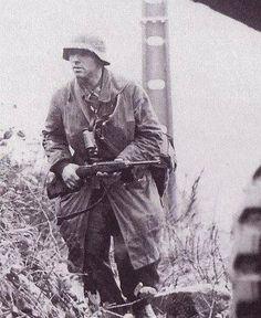German solder using an M1 Carbine outside of Belgian 1945