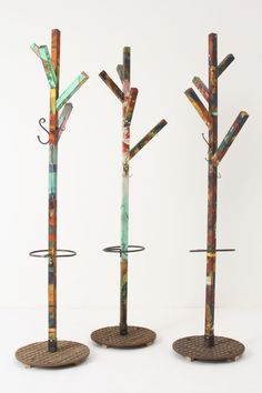 Splashed Coat Rack: sourced from Amsterdam grounds a paint-splattered, circa 1950-1960 wooden tower. Extra metal hooks and an umbrella holder make sure there's a place for everything. No two are exactly alike.   DIY- Anthropologie.com