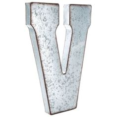 "Put a vintage-inspired spin on monogram letters using this stylish Large Galvanized Metal Letter - V! This oversized hollow metal letter features a distressed-edged galvanized metal finish and a stunning font style. Spell a name or team name, or display initials, words, and more with this unique, lightweight rustic letter!    	Dimensions:    	  		Length: 20 3/4""  	  		Width: 13 1/2""  	  		Thickness: 2""      	Hanging Hardware:    	  		2 - Hanging Holes (12 3/4"" from ..."