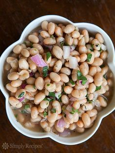 Quick and Easy White Bean Salad ~ Simple white bean salad with red onions, a little lemon juice, chopped parsley, olive oil, vinegar, herbs, salt and pepper. ~ SimplyRecipes.com