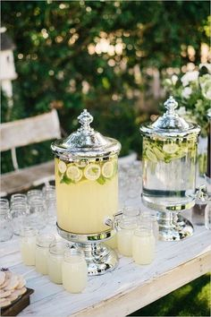dispensers with water and cucumbers and lemonade with lemons http://www.itgirlweddings.com/blog/how-to-get-that-bridal-glow