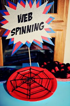 "Spiderman Party Game:""WEB SPINNING"" was a fun, indoor craft activity, in which the children wove their own spider webs using black wool and paper plates!!"