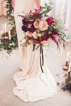 Wild and rustic bohemian wildflower bridal bouquet in beautiful sumptuous reds, burgundy and pink theme. Image 10 - Floral delight in Styled Shoots.