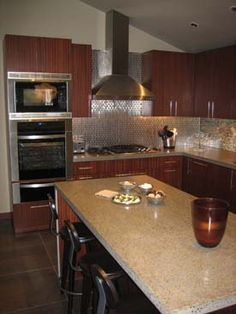 Sapele Wood cabinets and porcelain floor tiles with concrete countertop.