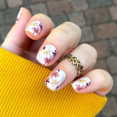 Embrace the FLOWER POWER when you put on 'Fall Fresh' featuring playful blossoms in all of your favorite fall colors covering a white, matte background. #fall #nails #diynails #mani #nailart #diynailart #fallnails #autumn