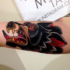 Traditional Wolf Tattoo by Jonathan Montalvo @montalvotattoos jonathanmontalvo montalvotattoos traditional wolf #TraditionalTattoos