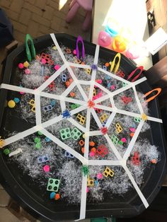 Eyfs funky fingers. Numicon in the spiders web rescue with tweezers