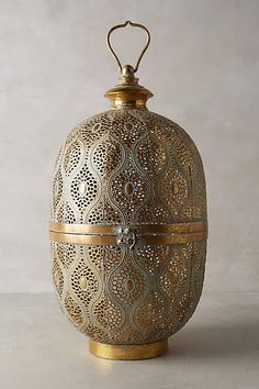 Anthropologie EU Tantallon Lantern. Bask in the glow of these exotic lanterns, just the thing to add a warm ambiance to your space on frosty days and chilly nights.