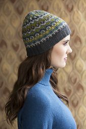 Osborn displays four shades of The Fibre Company's Cumbria Fingering in a fitted hat that's banded with petite Bohus-inspired colorwork motifs. Worked seamlessly, it begins with a provisional cast-on for the double-rib brim, which is folded under before the stitches are joined and the main patterning begins. Decreases worked into the colorwork pattern shape the softly peaked crown.  Double work brim done with provisional cast on and then folded under before continuing with remainder of hat.