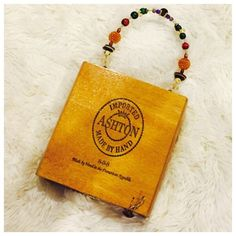"""Vintage Handmade Cigar Box Purse Made by hand in the Dominican Republic. Beaded handle. Snap closure with additional button decal loop closure on side. In good condition. Measures 6 1/2"""" W x 7"""" H x 2 1/4"""" D. Boutique Bags Satchels"""