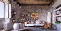 Living room with warm touches located in a stone tower in...