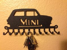 Mini Key Holder...These also work great for lanyards, medals, ties, rings and jewelry!  CNC plasma cut steel. Powder coated wrinkle black. Will hold ten