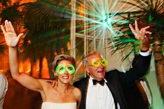 Bride and her father with neon glasses on the wedding reception at Palmenhaus, Vienna, Austria www.samorovan.com