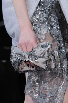 A sparkling bow clutch at Alexis Mabille Fall 2014 - Best Runway Bags Paris Fashion Week Bags #PFW