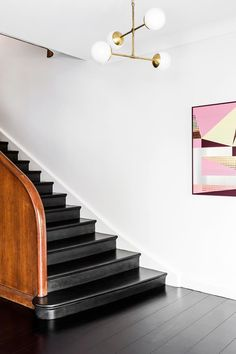 With the help of interior design firm Arent&Pyke and architect Luke Moloney, this original Spanish Mission home in North Sydney has been successfully updated for modern family living. Take a tour. Black Floorboards, Douglas And Bec, Black Staircase, Cedar Walls, Wooden Staircases, Stairways, Best Ceiling Fans, Curved Wood, Best Flooring