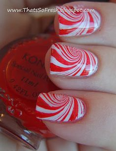 Cool, just Skip candy canes and play with candy mints instead. Place drops of red and white polish into a bowl of water, mix and dip your fingers in to create swirls of color.