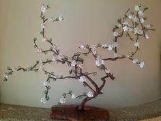 Árvore elaborada através de uma raiz. carisarte.blogspot.pt