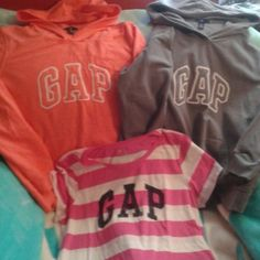 2 gap goodies and 1 tshirt 1 bright peach and 1 gray gap hoodie both like new worn once, also pink striped tshirt all ladies xlarge, selling all three together. GAP Tops