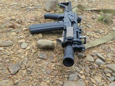 Krink with Midwest Handguard, Bulgarian muzzle brake, and folding stock