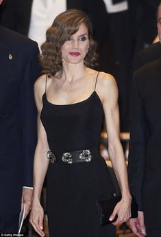 Queenstunned in a figure-hugging black dress as she joined her husband King Felipe VI for...